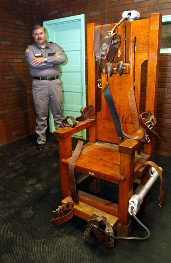 Aaron Dickson, President of the Board of Directors of the Texas Prison Museum stands on November 19, 2002 with